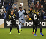 Independiente players (from left) Omar Cordoba, Abdiel Ayarza, and Omar Browne vie for the ball with Gerso Fernandes (center) of Sporting KC.  Sporting KC defeated Club Atletico Independiente 3-0 in a CONCACAF Champions League quarterfinal game at Children's Mercy Park on March 14, 2019.
