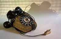 Cables tangling up an obsolete phone.