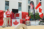 LONDON, ENGLAND – 08/26/2012:  Canada's Flag-bearer Garett Hickling is introduced by Lis Walker-Young and Gaetan Tardif before the London 2012 Paralympic Games. (Photo by Matthew Murnaghan/Canadian Paralympic Committee)
