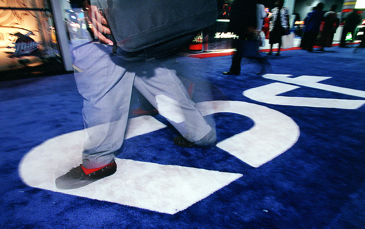 9/11/97.CONGRESSIONAL BLACK CAUCUS FOUNDATION ANNUAL LEGISLATIVE CONFERENCE--Attendees walk across the Black Caucus logo at the entrance to the trade show portion of the conference at the D.C. Convention Center..CONGRESSIONAL QUARTERLY PHOTO BY SCOTT J. FERRELL