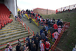 Sheffield United supporters making their way out of the Kop Stand and the end of the Npower Championship fixture with Leeds United. The home team won the game by two goals to nil watched by a crowd of 23,728. Bramall Lane is the world's oldest professional football ground and at one time hosted both football and cricket.