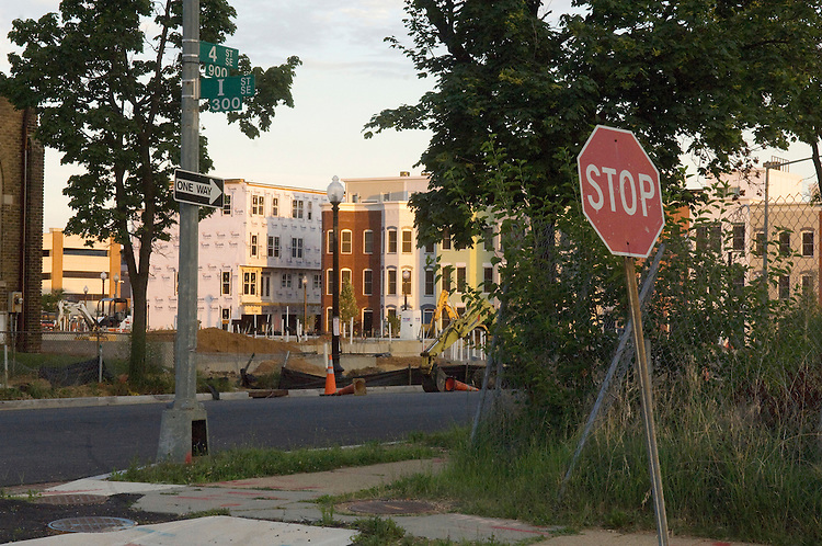 "WASHINGTON, DC - July 09: View from the site of the first phase of the Capitol Quarter townhouses in Washington, on the triangular block bounded by Virginia Avenue, Third, Fourth, and I Streets, where 61 'market-rate"" townhouses have been sold, and 20 ""workforce""-rate houses have also been reserved, with another 32 to be sold. The homes are part of a first phase of development that will include eight Section 8 ownership homes and 39 subsidized rental units. The site is being developed with $34.9 million Hope VI grant to redevelop the 23-acre Capper/Carrollsburg public housing project as a mixed-income development. (Photo by Scott J. Ferrell/Congressional Quarterly)"