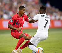 KANSAS CITY, KS - JUNE 26: Reggie Cannon #14 is challenged by Jose Fajardo #17 during a game between United States and Panama at Children's Mercy Park on June 26, 2019 in Kansas City, Kansas.