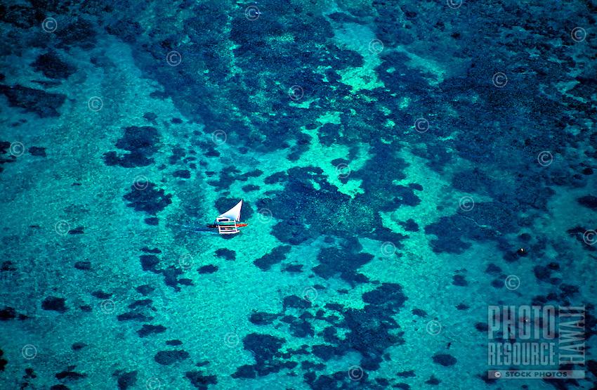 Sailing over Hawaii's crystal clear waters near Oahu