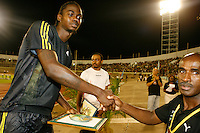 Antwon Hicks accepting his award from Donald Quarrie at the Jamaica International Invitational Meet on Saturday, May 2nd. 2009. Photo by Errol Anderson, The Sporting Image.net