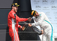 SEBASTIAN VETTEL (GER) of Scuderia Ferrari and LEWIS HAMILTON (GBR) of Mercedes-AMG Petronas Motorsport on the podium during The Formula 1 2018 Rolex British Grand Prix at Silverstone Circuit, Northampton, England on 8 July 2018. Photo by Vince  Mignott.