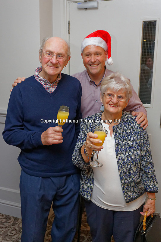 Pictured L-R: Graham Page, 82 with wife Bronny from Barry with one of the organisers (TOP).  Wednesday 28 November 2018<br /> Re: National Lottery millionaires from south Wales and the south west of England have hosted a glitzy Rat Pack-inspired Christmas party for an older people's music group at The Bear Hotel in Cowbridge, Wales, UK.