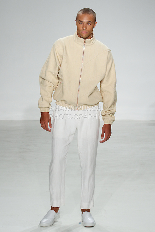 Model walks runway in a cream canvas lounge jacket and white linen Hollywood trouser, from the Palmiers du Mal Spring Summer 2017 collection by Brandon Capps and Shane Fonner, at Skylight Clarkson Square on July 14 2016, during New York Fashion Week Men's Spring Summer 2017.