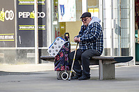 Pictured: A shopper sits down with his toilet paper in Swansea City Centre during the Covid-19 Coronavirus pandemic in Wales, UK, Swansea, Wales, UK. Monday 23 March 2020