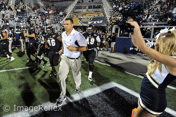 12 November 2011:  FIU's team, led by Head Coach Mario Cristobal, take the field prior to the game.  The FIU Golden Panthers defeated the Florida Atlantic University Owls, 41-7, to win the annual Shula Bowl game, at FIU Stadium in Miami, Florida.