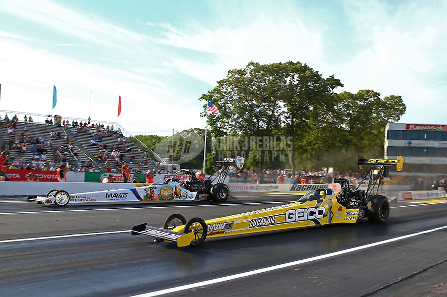 May 31, 2013; Englishtown, NJ, USA: NHRA top fuel dragster driver Morgan Lucas (near lane) races alongside Brandon Bernstein during qualifying for the Summer Nationals at Raceway Park. Mandatory Credit: Mark J. Rebilas-