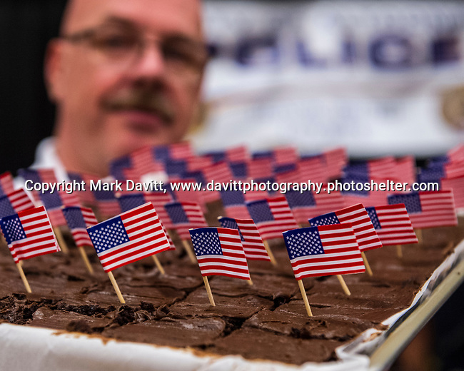 The Altoona Chamber of Commerce again hosted Taste of Altoona at Prairie Meadows Sept. 5. The event offers Altoona area residents an opportunity to sample appetizers, entrees and desserts from area businesses. Lee Richardson, Altoona Assistant Fire Chief, shows off Patriotic Brownies offered by the fire and police departments.