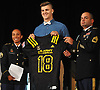 Jeremy Ruckert, Lindenhurst High School senior, gets presented with a jersey after officially being named a US Army All-American at the school on Monday, Oct. 2, 2017. Standing alongside him are Staff Sergeant Sarah Marrero and Sergeant First Class Adony Batista.