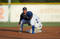 Maikel Garcia (2) of the Burlington Royals is forced out at second base by Pulaski Yankees Pulaski Yankees shortstop Jesus Bastidas (39) at Burlington Athletic Stadium on August 25, 2019 in Burlington, North Carolina. The Yankees defeated the Royals 3-0. (Brian Westerholt/Four Seam Images)