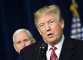 United States President Donald J. Trump makes remarks to the media at Camp David, the presidential retreat near Thurmont, Maryland after holding meetings with staff, members of his Cabinet and Republican members of Congress to discuss the Republican legislative agenda for 2018 on January 6, 2018.   Looking on is US Vice President Mike Pence.<br /> Credit: Chris Kleponis / Pool via CNP