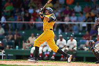 Jacksonville Suns outfielder Matt Juengel (15) hits a home run during the 20th Annual Rickwood Classic Game against the Birmingham Barons on May 27, 2015 at Rickwood Field in Birmingham, Alabama.  Jacksonville defeated Birmingham by the score of 8-2 at the countries oldest ballpark, Rickwood opened in 1910 and has been most notably the home of the Birmingham Barons of the Southern League and Birmingham Black Barons of the Negro League.  (Mike Janes/Four Seam Images)