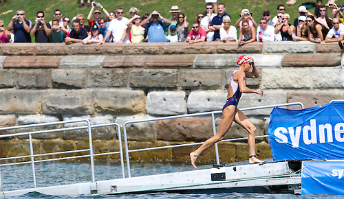 10 APR 2011 - SYDNEY, AUS - Laura Bennett  leads the field out of the water at the end of the first lap of the swim during the women's ITU World Championship Series triathlon in Sydney, Australia .(PHOTO (C) NIGEL FARROW)