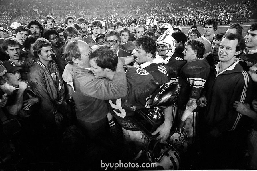 FTB 411 R 38 Holiday Washington<br /> <br /> Holiday Bowl vs Washington. Coach LaVell Edwards with 9 Jim McMahon.<br /> <br /> December 14-18, 1981<br /> <br /> Box Number: 6375 or 6376<br /> <br /> Photo by: Mark Philbrick/BYU<br /> <br /> Copyright BYU PHOTO 2008<br /> All Rights Reserved<br /> 801-422-7322<br /> photo@byu.edu