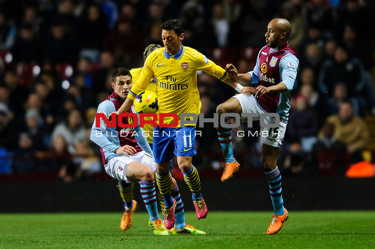 Arsenal Midfielder Mesut Ozil (GER) is challenged by Aston Villa Midfielder Fabian Delph (ENG) during the first half of the match -  - 13/01/2014 - SPORT - FOOTBALL - Villa Park, Birmingham - Aston Villa v Arsenal  - Barclays Premier League.<br /> Foto nph / Meredith<br /> <br /> ***** OUT OF UK *****