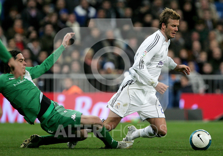 Real Madrid's David Beckham fouled by Betis' player during Spain's La Liga match at Santiago Bernabeu stadium in Madrid, Saturday February 17, 2007. (ALTERPHOTOS/Alvaro Hernandez).