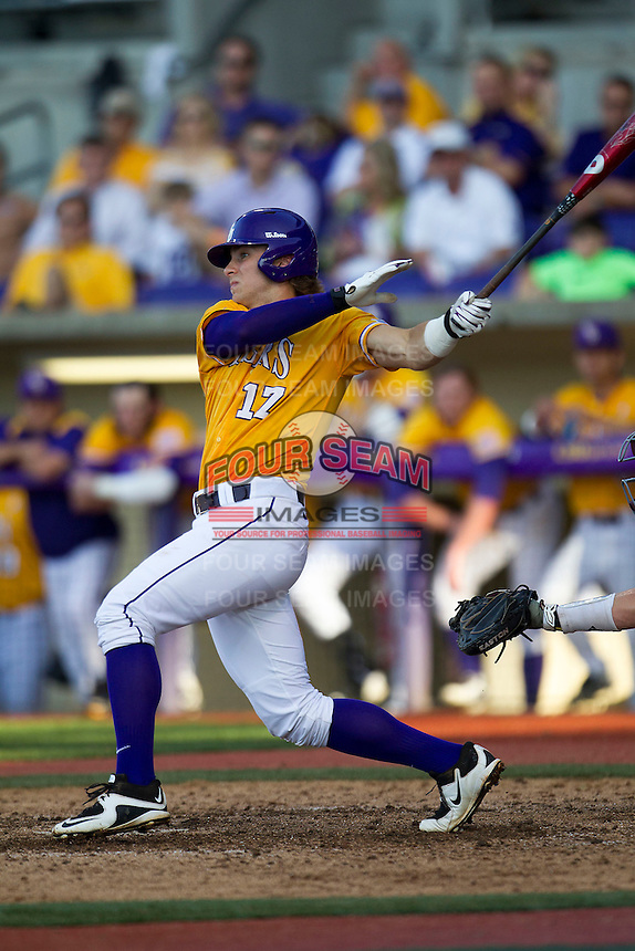 LSU Tigers second baseman Jared Foster (17) follows through on his swing during the Southeastern Conference baseball game against the Texas A&M Aggies on April 25, 2015 at Alex Box Stadium in Baton Rouge, Louisiana. Texas A&M defeated LSU 6-2. (Andrew Woolley/Four Seam Images)