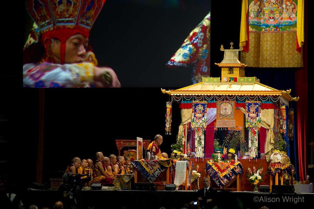 The Dalai Lama giving Kalachakra teachings at the Verizon center, 2011, Monks in dance ritual.