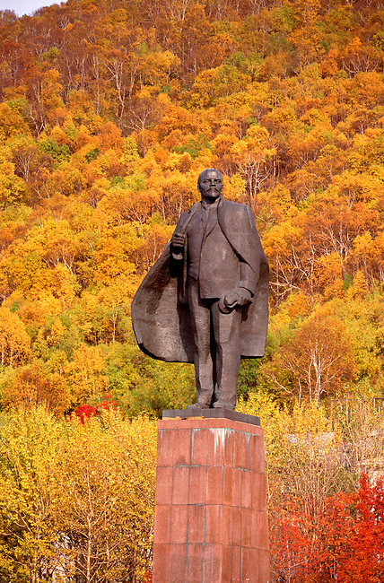 The statue of Lenin in Petropavlovsk surrounded by autumn colour. Kamchatka, Siberia, Russia.