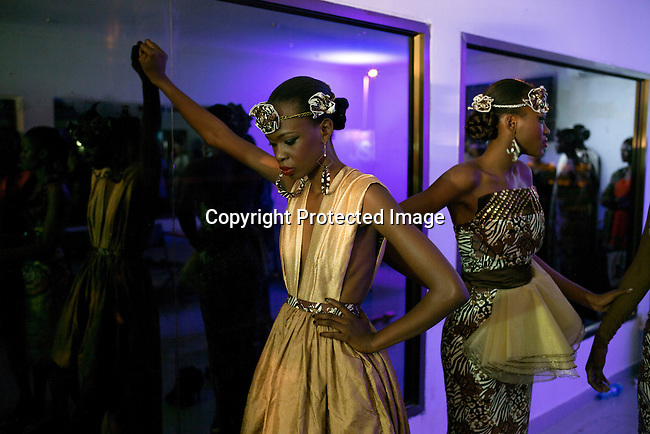 JULY 25: Models walking for the designer Tiffahny Dians waits backstage before a show at Kinshasa Fashion Week on July 25, 2015, at the boxing gym at Shark club in Kinshasa, DRC. Local and invited foreign-based designers showed their collections during the 2015 edition of Kinshasa Fashion week. (Photo by Per-Anders Pettersson)