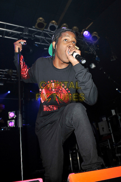 A$AP Rocky (Rakim Mayers) performing live in concert, Electric Ballroom, Camden, London, England. .5th June 2012.on stage in concert live gig performance music half length black camouflage hat top singing jeans denim red print classics hood paramount .CAP/MAR.© Martin Harris/Capital Pictures.