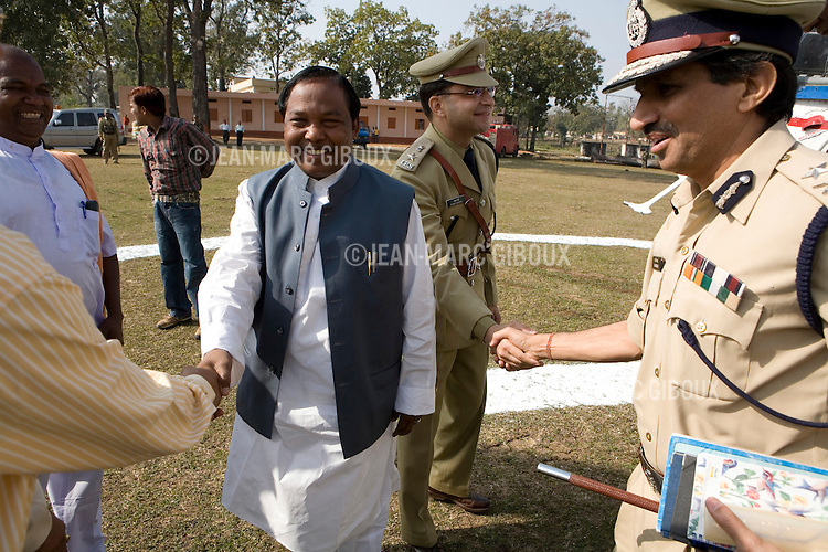 """DANTEWARA, CHHATTISGARH, INDIA, FEBRUARY 27, 2008 : Graduation ceremony for the graduation of the new recruits of the 9th Battallion of Chattisgarh Armed Police with the visit of Chhattisgarh's Home Minister Ram Vichar Netam and police officials, including Dantewara Superintendant of Police, Rahul Sharma (uniform no mustache). The Maoist insurgency called Naxalites have been waging a war against the government for the past 25 years and has been gaining momentum in in the past few years. They are present in some 150 of the 600 districts of India, and Dantewara is one of Chhattisgarh rural Maoist stronghold where they control most of the countryside. The overwhelmed police force is hiring more personel to deal with the Naxalite threat and the Government has armed civil defence anti-naxalite milicias to take on the naxalites , emptying villages to cut local support to the rebels. The movement called """"Salwa Judum"""" (campaign for peace in the  started in june 2005 when some villages took a stand against the Maoists, but it is dragging the whole district into the bloody civil war, at the expense of the  local tribal villagers caught in the middle, making it the deadliest theater of the war. The conflict has claimed over 900 lives in 2006 and again in 2007, and some 50 to 60,000 people live in makeshift camps, displaced from their ancestral villages. (Photo by Jean-Marc Giboux/GettyImages)"""