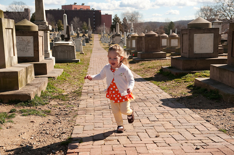 UNITED STATES - FEBRUARY 23:  Samantha Vucci, 2 1/2, makes her way through Historic Congressional Cemetery in Southeast.  Dog owners are able to become members of the cemetery and use it as place to walk their dogs. (Photo By Tom Williams/CQ Roll Call)