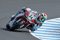 Davide Giugliano (ITA) riding the Aprilia RSV4 1000 Factory (34) of the Althea Racing team rounds turn 6 during a qualifying session on day one of round one of the 2013 FIM World Superbike Championship at Phillip Island, Australia.