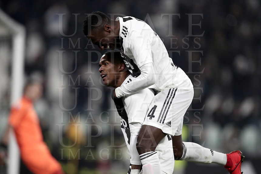 Calcio, Serie A: Juventus - Chievo Verona, Turin, Allianz Stadium, January 21, 2019.<br /> Juventus' Douglas Costa celebrates after scoring with his teammate Blaise Matuidi (top) during the Italian Serie A football match between Juventus and Chievo Verona at Torino's Allianz stadium, January 21, 2019.<br /> UPDATE IMAGES PRESS/Isabella Bonotto
