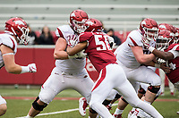 Hawgs Illustrated/BEN GOFF <br /> Dalton Wagner, Arkansas offensive lineman, graples with defensive lineman Zach Williams in the fourth quarter Saturday, April 6, 2019, during the Arkansas Red-White game at Reynolds Razorback Stadium.