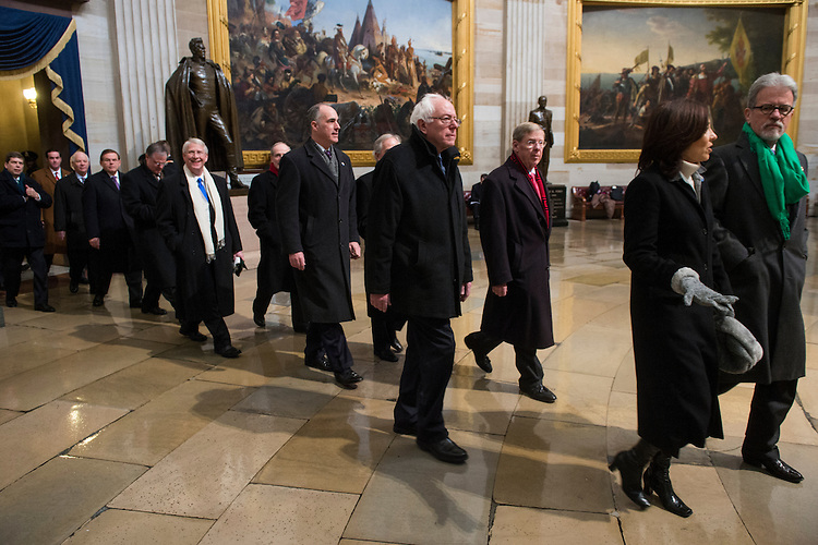 UNITED STATES - JANUARY 21: Senators walk through the Rotunda on their way to the West Front of the Capitol for President Barack Obama's inauguration ceremony on Monday, Jan. 21, 2013. (Photo By Bill Clark/CQ Roll Call)