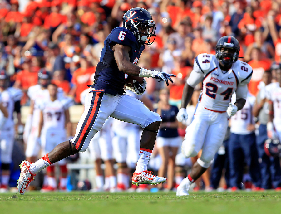 Virginia wide receiver Darius Jennings (6) with a catch and long run between Richmond defenders during the 3rd quarter of the game Saturday Sept. 6, 2014 at Scott Stadium in Charlottesville, VA. Virginia defeated Richmond 45-13. Photo/Andrew Shurtleff