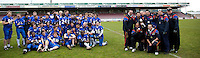 09 MAY 2010 - NORTHAMPTON, GBR - Birmingham Lions coaches (right) pose for a photo watched by their players  after the teams victory over Loughborough Aces in the British Universities American Football Championship Final (PHOTO (C) NIGEL FARROW)