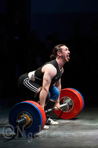10 MAY 2014 - COVENTRY, GBR - Mehmed Fikretov from the Crystal Palace Weightlifting Club prepares to lift during the men's 77kg A category round at the British 2014 Senior Weightlifting Championships and final 2014 Commonwealth Games qualifying event round at the Ricoh Arena in Coventry, Great Britain (PHOTO COPYRIGHT © 2014 NIGEL FARROW, ALL RIGHTS RESERVED)