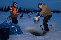 J.Sousa Gets Water @ Lake for Dog Food Finger Lake<br /> 2004 Iditarod