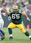 GREEN BAY, WI - OCTOBER 19: Offensive lineman Mark Tauscher #65 of the Green Bay Packers prepares to block against the Indianapolis Cots at Lambeau Field on October 19, 2008 in Green Bay, Wisconsin. The Packers beat the Colts 34-14. (Photo by David Stluka)