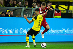 10.11.2018, Signal Iduna Park, Dortmund, GER, 1.FBL, Borussia Dortmund vs FC Bayern M&uuml;nchen, DFL REGULATIONS PROHIBIT ANY USE OF PHOTOGRAPHS AS IMAGE SEQUENCES AND/OR QUASI-VIDEO<br /> <br /> im Bild | picture shows:<br /> Joshua Kimmich (Bayern #32) im Duell mit Achraf Hakimi (Borussia Dortmund #5), <br /> <br /> Foto &copy; nordphoto / Rauch