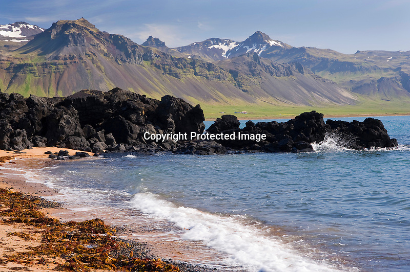 Lava Formations and Quiet Beach in the Former Fishing Village of Budir in West Iceland