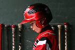 Eight-year-old Sean Swanson waits between innings in the dugout during a baseball game between Shanley and Fargo South high schools on Thursday, May 24, 2007, at Jack Williams Stadium. Swanson is the bat boy for Shanley. His father, Joel, is Shanley's head coach. .