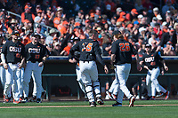 Oregon State Beavers catcher Adley Rutschman (35) congratulates starting pitcher Bryce Fehmel (26) between innings of a game against the Gonzaga Bulldogs on February 16, 2019 at Surprise Stadium in Surprise, Arizona. (Zachary Lucy/Four Seam Images via AP)