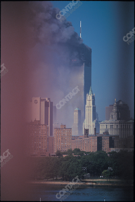 Attack on the World Trade Center, view from Williamsburg Bridge, north tower burning after the collapse of the South tower, New York City, New York, USA, September 11, 2001