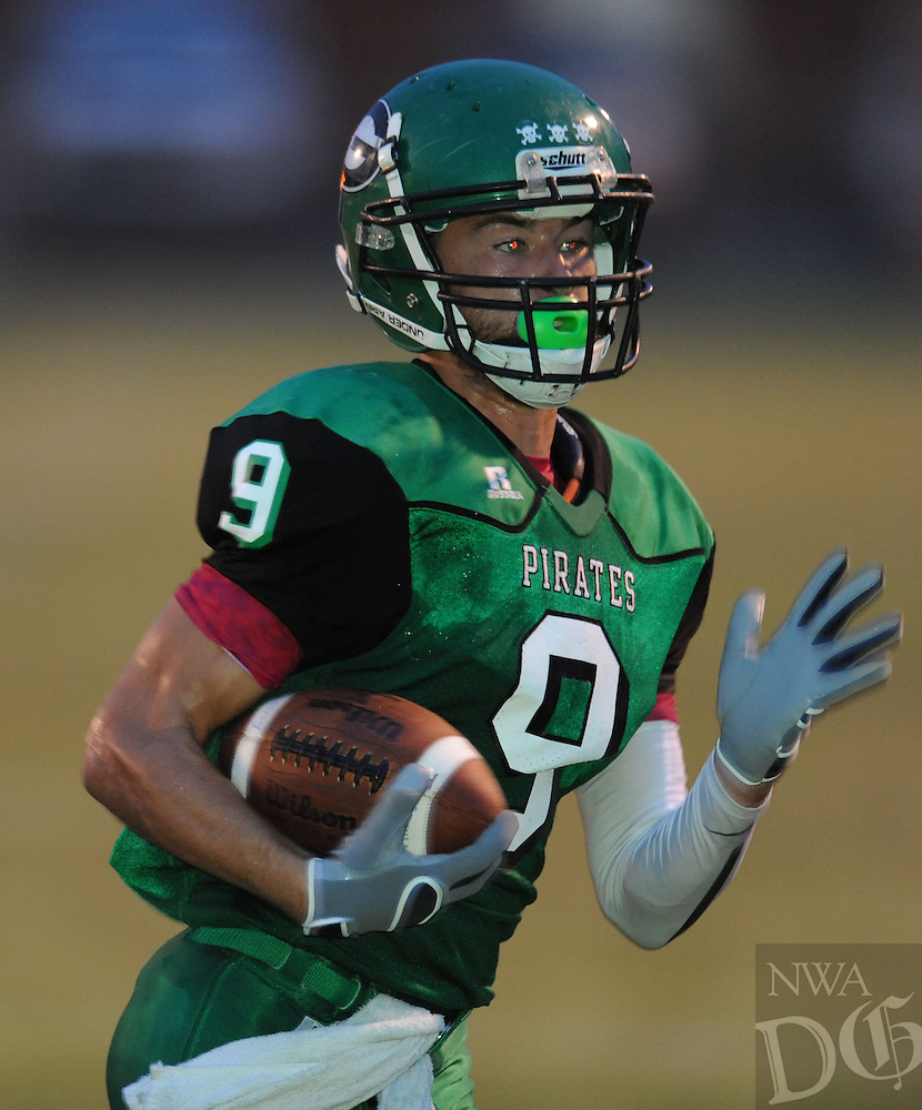 NWA Democrat-Gazette/ANDY SHUPE<br /> Hayes Rhodes (9) of Greenland carries the ball after making a touchdown pass on fourth and long against Gentry Friday, Sept. 18, 2015, during the first half of play at Jonathan Ramey Memorial Stadium in Greenland. Visit nwadg.com/photos to see more photographs from the game.