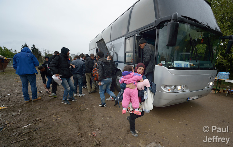 Refugees get off a bus and prepare to cross the border into Croatia near the Serbian village of Berkasovo. Hundreds of thousands of refugees and migrants from Syria, Iraq and other countries--including many children--have flowed through Serbia in 2015, on their way to western Europe.