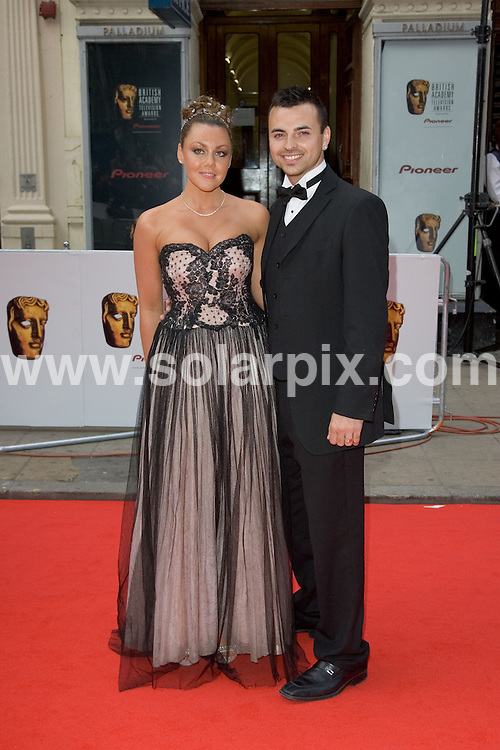 ALL ROUND PICTURES FROM SOLARPIX.COM.**WORLDWIDE RIGHTS*.Celebrities attend the 2007 TV Bafta Awards held at the London Palladium on 20.05.07.  The event was hosted by Graham Norton.  This pic:.Michelle Heaton and Andy Scott Lee..REF:  3966     PRS        DATE: 20.05.07.**MUST CREDIT SOLARPIX.COM OR DOUBLE FEE WILL BE CHARGED* *UNDER NO CIRCUMSTANCES IS THIS IMAGE TO BE REPRODUCED FOR ANY ONLINE EDITION WITHOUT PRIOR PERMISSION*