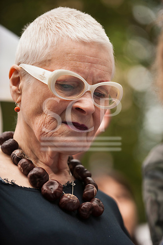 Designer Vivienne Westwood wears a necklace of horse chestnuts - conkers - as she marches in during the Climate Change demonstration, London, 21st September 2014. © Sue CunninghamDesigner Vivienne Westwood wears a necklace of horse chestnuts - conkers - as she marches in during the Climate Change demonstration, London, 21st September 2014. © Sue Cunningham