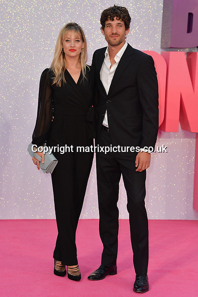 NON EXCLUSIVE PICTURE: MATRIXPICTURES.CO.UK<br /> PLEASE CREDIT ALL USES<br /> <br /> WORLD RIGHTS<br /> <br /> American television personality and singer Kimberly Wyatt and husband English model Max Rogers attend the world premiere of &quot;Bridget Jones's Baby&quot; at Leicester Square in London.<br /> <br /> SEPTEMBER 5th 2016<br /> <br /> REF: JWN 162864